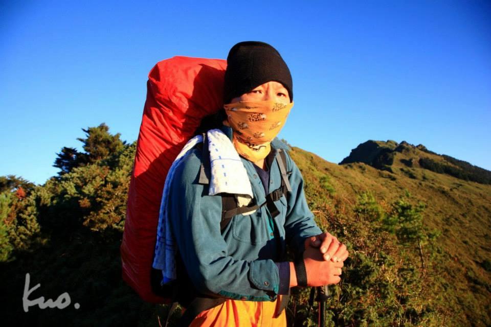 圖二十:2009.9.22.溫哥於能高主山。能安、安能、又去回,我倆躑躅道中不知凡幾,老郭讚為世界級的縱走路線。